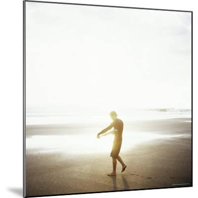 Young Man Waxes His Board Before Entering Marabella's Waves, Costa Rica, Central America-Aaron McCoy-Mounted Photographic Print