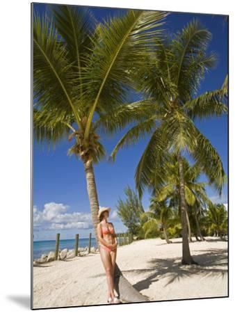 Woman Leaning Against Palm Tree, Princess Cays, Eleuthera Island, West Indies, Caribbean-Richard Cummins-Mounted Photographic Print