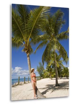 Woman Leaning Against Palm Tree, Princess Cays, Eleuthera Island, West Indies, Caribbean-Richard Cummins-Metal Print