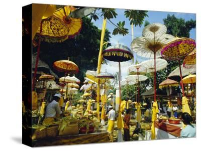 Parasols in Taman Pile Hindu Temple on Koningan Day, Bali, Indonesia-Robert Francis-Stretched Canvas Print