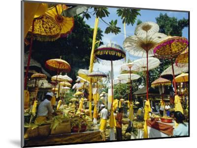 Parasols in Taman Pile Hindu Temple on Koningan Day, Bali, Indonesia-Robert Francis-Mounted Photographic Print