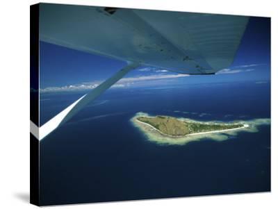 Float over Vomo Island, Fiji-David Wall-Stretched Canvas Print