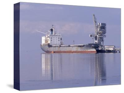Cargo Tanker Ship Tied Up to a Jetty, Reflecting in the Calm Harbour, Australia-Jason Edwards-Stretched Canvas Print