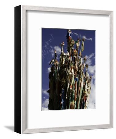 Cluster of Tibetan Prayer Flags against a Blue Sky with Clouds, Qinghai, China-David Evans-Framed Photographic Print