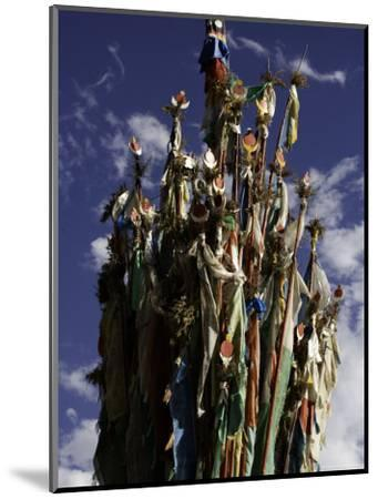 Cluster of Tibetan Prayer Flags against a Blue Sky with Clouds, Qinghai, China-David Evans-Mounted Photographic Print
