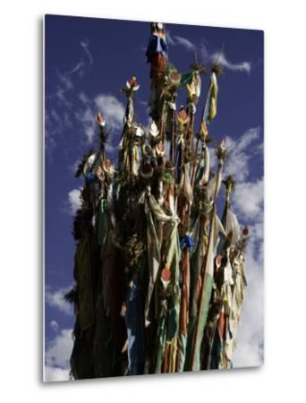 Cluster of Tibetan Prayer Flags against a Blue Sky with Clouds, Qinghai, China-David Evans-Metal Print