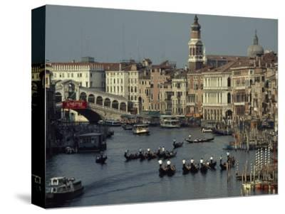 Boats Crowd the Grand Canal of Venice, Italy-James L^ Stanfield-Stretched Canvas Print