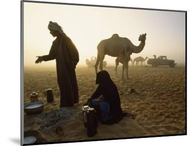 Bedouins Cooking on the Sand at their Camp at Sahamah, Oman-James L^ Stanfield-Mounted Photographic Print