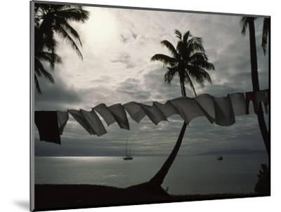 Buca Bay, Laundry and Palm Trees-James L^ Stanfield-Mounted Photographic Print