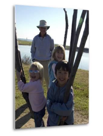 Kids Climb a Tree as their Grandpa Looks On, Washington, D.C.-Stacy Gold-Metal Print