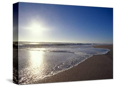 Gentle Waves Lap Onto a Pristine Sandy Beach with the Sun Reflecting, Australia-Jason Edwards-Stretched Canvas Print