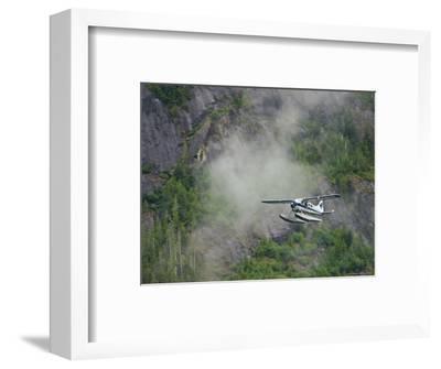 Float Plane against Granite Cliff, Alaska-Ralph Lee Hopkins-Framed Photographic Print