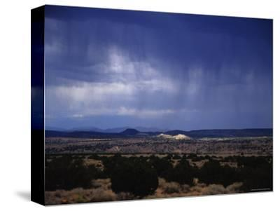 Rain Pores Down on the Desert Landscape in New Mexico-Stacy Gold-Stretched Canvas Print
