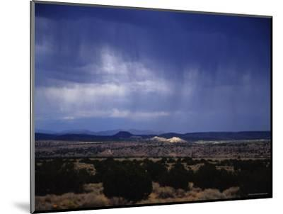 Rain Pores Down on the Desert Landscape in New Mexico-Stacy Gold-Mounted Photographic Print