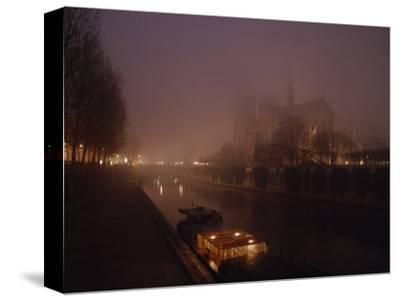 Night View Across the Seine Towards Notre Dame and the Ile de la Cite, Paris, France-James L^ Stanfield-Stretched Canvas Print