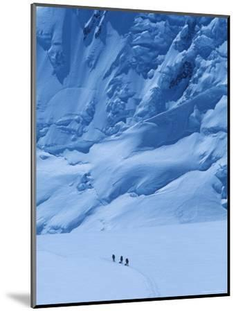 Three People Skiing Up the Kahiltna Glacier on Denali, Alaska-Bill Hatcher-Mounted Photographic Print