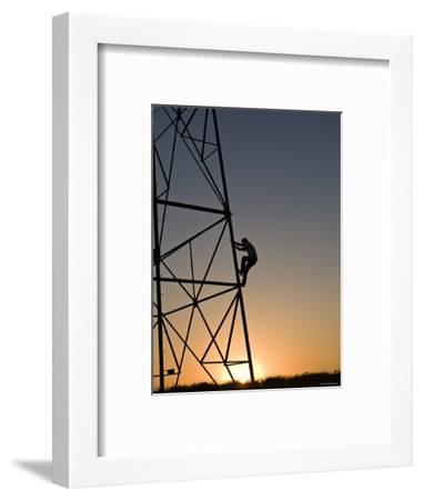 Silhouette of a Man Climbing a High Power Electric Line Tower, California-Dawn Kish-Framed Photographic Print