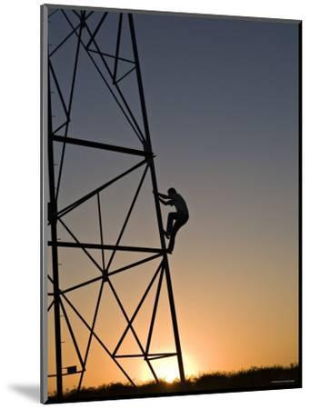 Silhouette of a Man Climbing a High Power Electric Line Tower, California-Dawn Kish-Mounted Photographic Print