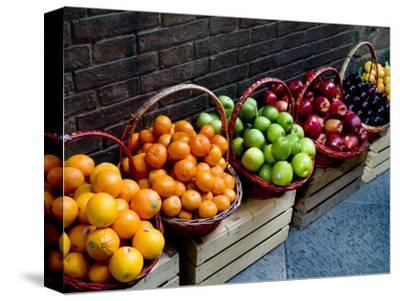 Six Baskets of Assorted Fresh Fruit for Sale at a Siena Market, Tuscany, Italy-Todd Gipstein-Stretched Canvas Print