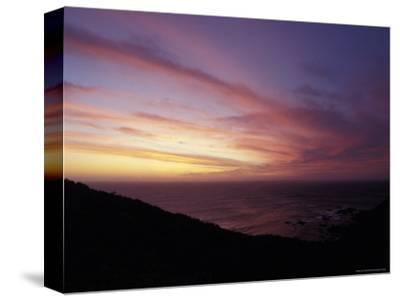 Sunset Reflects Off a Cloud Band Passing over a Rugged Coastline, Australia-Jason Edwards-Stretched Canvas Print