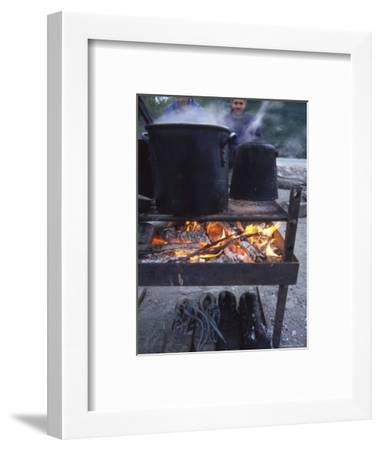 Two Men at Camp Are Drying their Shoes under Camp Cook Fire-Kate Thompson-Framed Photographic Print