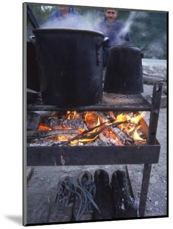 Two Men at Camp Are Drying their Shoes under Camp Cook Fire-Kate Thompson-Mounted Photographic Print
