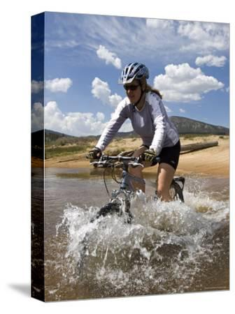 Woman Mountain Bikes Through Wild and Scenic South Fork Kern River-Rich Reid-Stretched Canvas Print