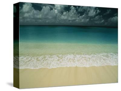 Wave Rolls over a Tranquil Beach in the Marshall Islands-Bill Curtsinger-Stretched Canvas Print
