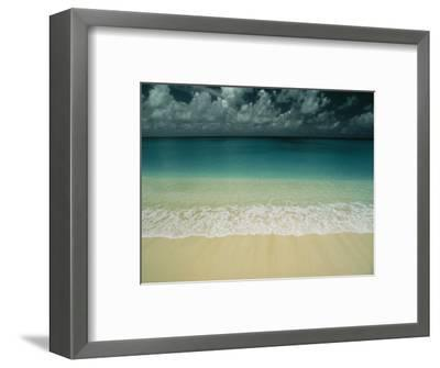 Wave Rolls over a Tranquil Beach in the Marshall Islands-Bill Curtsinger-Framed Photographic Print