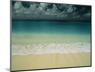 Wave Rolls over a Tranquil Beach in the Marshall Islands-Bill Curtsinger-Mounted Photographic Print