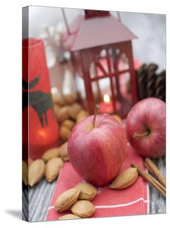 Christmas Decoration with Apples, Nuts, Cinnamon & Lantern--Stretched Canvas Print