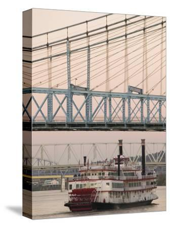 Riverboat on Ohio River and, Roebling Suspension Bridge, Cincinnati, Ohio, USA-Walter Bibikow-Stretched Canvas Print