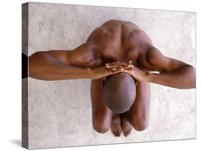 Aerial View of Nude Man Crouching--Stretched Canvas Print