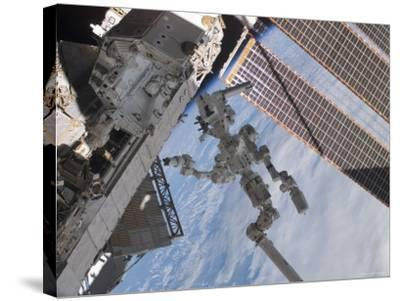 The Canadian-Built Dextre Robotic System in the Grasp of Canadarm2-Stocktrek Images-Stretched Canvas Print