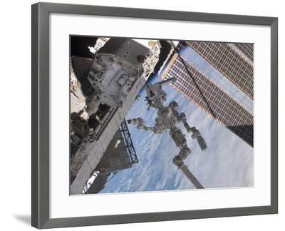 The Canadian-Built Dextre Robotic System in the Grasp of Canadarm2-Stocktrek Images-Framed Photographic Print