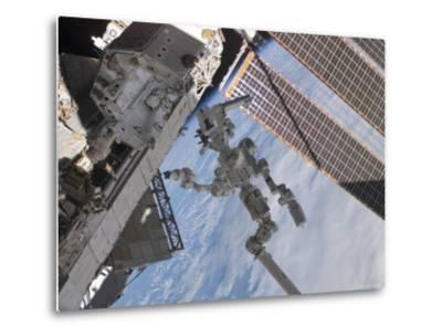 The Canadian-Built Dextre Robotic System in the Grasp of Canadarm2-Stocktrek Images-Metal Print