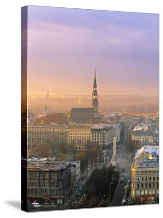 Freedom Monument and St. Peter's Church, Riga, Latvia-Jon Arnold-Stretched Canvas Print