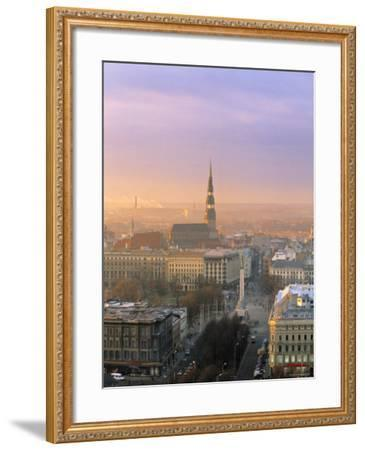 Freedom Monument and St. Peter's Church, Riga, Latvia-Jon Arnold-Framed Photographic Print