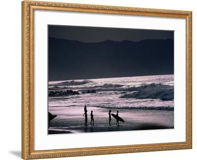 Surfers at Sunset, Ehukai, Oahu, Hawaii-Bill Romerhaus-Framed Photographic Print