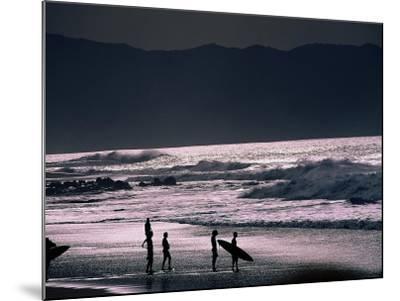 Surfers at Sunset, Ehukai, Oahu, Hawaii-Bill Romerhaus-Mounted Photographic Print