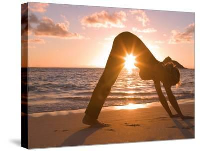 Woman Stretching on Beach-Tomas del Amo-Stretched Canvas Print