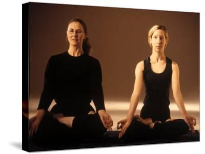 Two Women in Traditional Yoga Position-Jim McGuire-Stretched Canvas Print