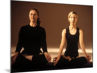 Two Women in Traditional Yoga Position-Jim McGuire-Mounted Photographic Print