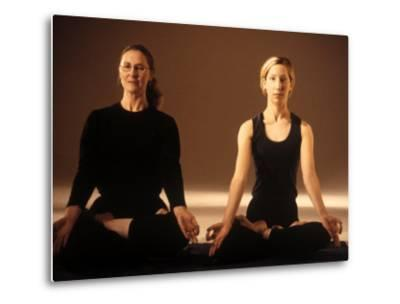 Two Women in Traditional Yoga Position-Jim McGuire-Metal Print