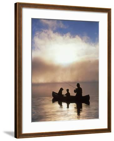 Silhouetted Father and Son Fishing from a Canoe-Bob Winsett-Framed Photographic Print