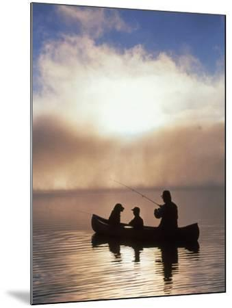 Silhouetted Father and Son Fishing from a Canoe-Bob Winsett-Mounted Photographic Print
