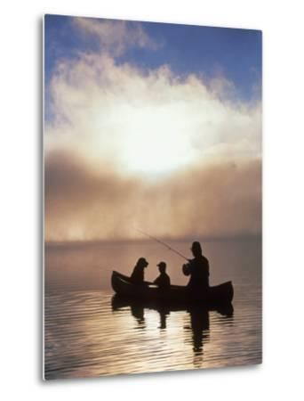 Silhouetted Father and Son Fishing from a Canoe-Bob Winsett-Metal Print