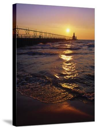 Sunset at Lighthouse, Lake MIchigan, MI-Mark Gibson-Stretched Canvas Print