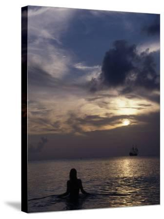 Woman Looking at Tall Ship, Cayman Islands-Bruce Clarke-Stretched Canvas Print