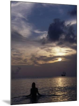 Woman Looking at Tall Ship, Cayman Islands-Bruce Clarke-Mounted Photographic Print